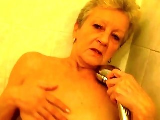 Grannie Takes Oral fulfillment From a dark haired stunner porn tube