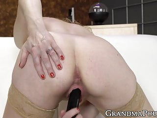 Fit grannie uses fucktoy to screw her slickly hairless coochie rock-hard sex tube